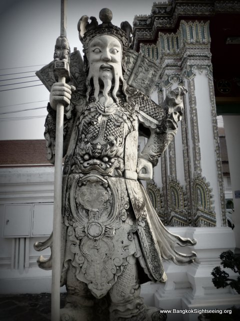Giant stone guardian at Wat Po